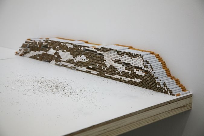 Koo Jeong-a, Untitled, 2011 wood painted on white mat, cigarettes, 15 metal legs
