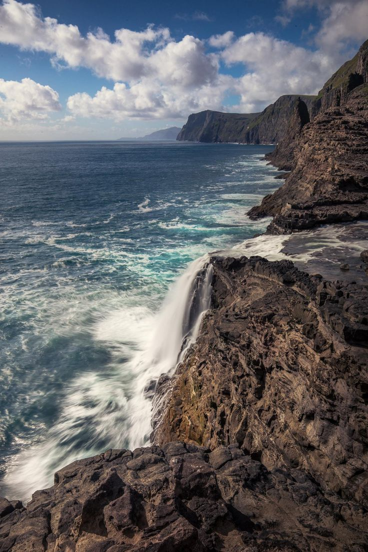Faroe Islands - place where local lake meets Atlantic Ocean [1365  2048] [OC]