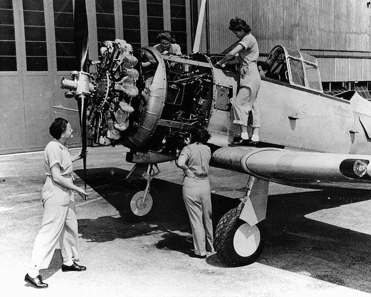 WAVES Aviation Machinist's Mates working on a SNJ training plane and its Pratt & Whitney R-1340 radial engine, Naval Air Station, Jacksonville, Florida, United States, 24 July 1943 (Source: United States National Archives)