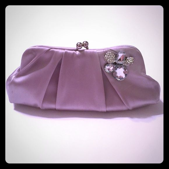 TAKE 25% OFF Charming Charlie Silver Clutch Bag! TAKE AN EXTRA 25% OFF! Just offer or ask for price drop!From Charming Charlie's (RSVP is their brand:)), only used one day for a wedding. Silver clutch that converts into an evening bag with silver chain shoulder strap that you can use or tuck away as desired. Very good used condition. Size added shortly. Charming Charlie Bags Clutches & Wristlets