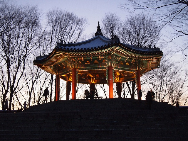 Sunset at Seoul Tower - The octagonal pavilion adjacent to the Seoul Tower shines brightly on Namsan Mountain as the sun begins to set. For amazing views of the city, head up to the top of Namsan Mountain at sunrise or sunset. To get there: Take the #2 bus at the bus stop just outside of exit 2 at Chungmuro Station (Lines 3 & 4).