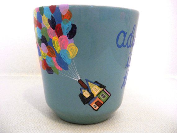 Start your daily adventures off with this coffee mug is inspired by the Disney movie Up. It features the flying house with balloons and includes