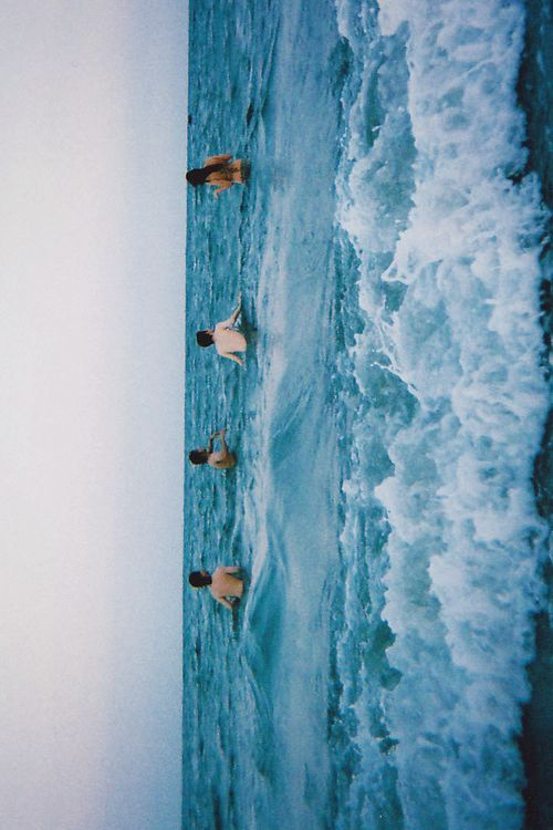 beck and danielle go swimming with someone hawaiian hippies (the two on the left if you tilt your head)