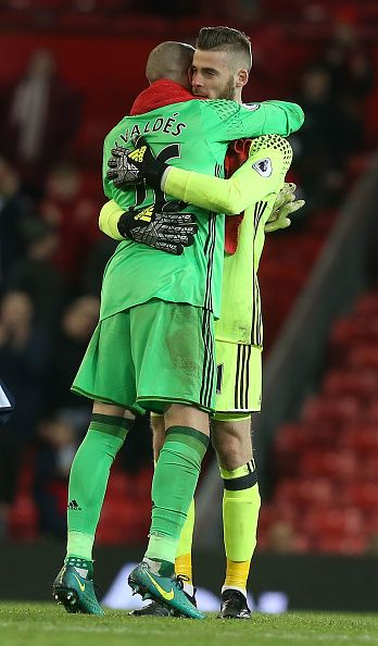 David de Gea of Manchester United walks off with Victor Valdes of Middlesbrough after the Premier League match between Manchester United and...
