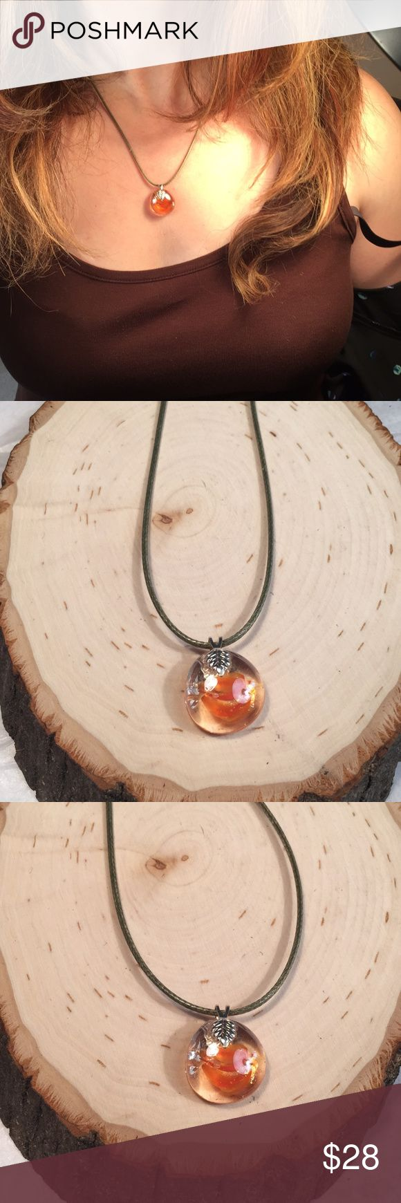Pretty flower necklace clear orange handmade new New handmade clear and organge pendant necklace. made of glass. Comes on jewelry card, in pink organza gift bag. Olive green Necklace cord approx. 18 inches long, lobster claw clasp, adjustable. Pendant clear & looks like a pretty orange flower inside, pendant is about the size of a dime or penny. Back is flat. Pretty handmade necklace. flower necklace Jewelry Necklaces