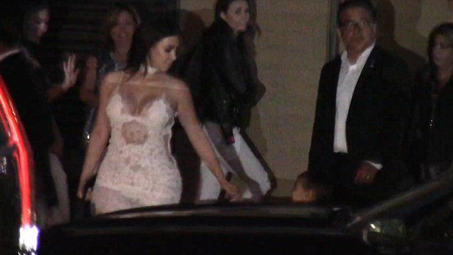 Kim Kardashian shows off her curves in sheer, white lace dress for Scott Disick's birthday party