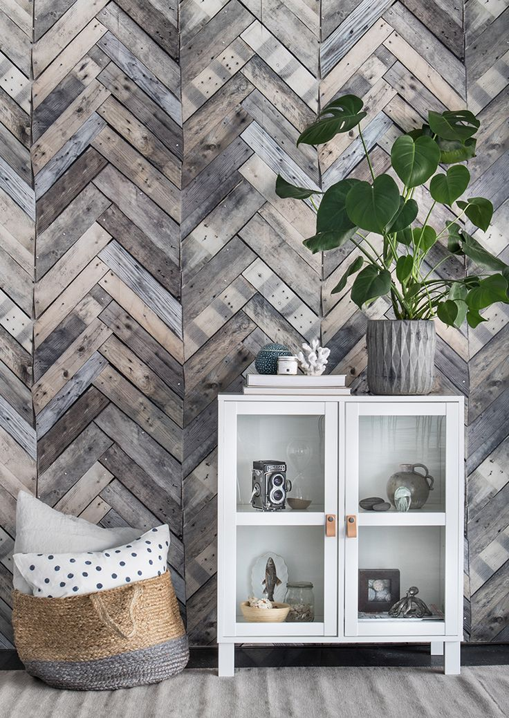 A stylish wallpaper mural with a unique herringbone pattern on well-worn wooden boards.