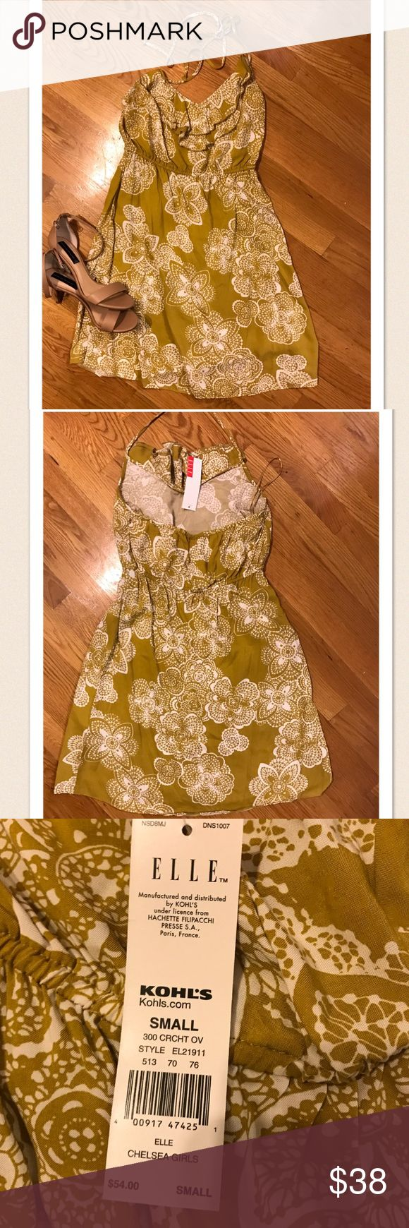 NWT yellow and white halter sundress NWT!!! Super cute yellow and white flowered halter sundress ELLE  Dresses