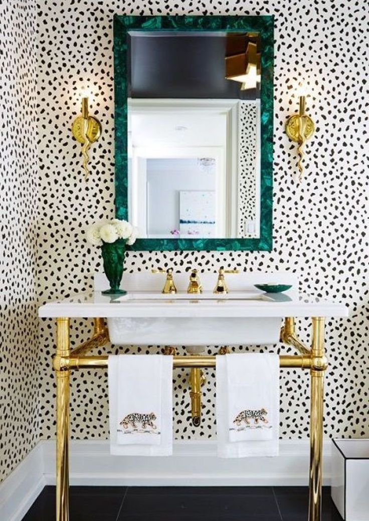 Loving this #leopard print #wallpaper and polished brass console legs!