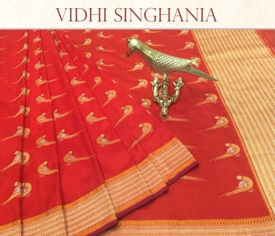 The traditional parrot design of Vidhi Singhania in this lovely red benarasi weave
