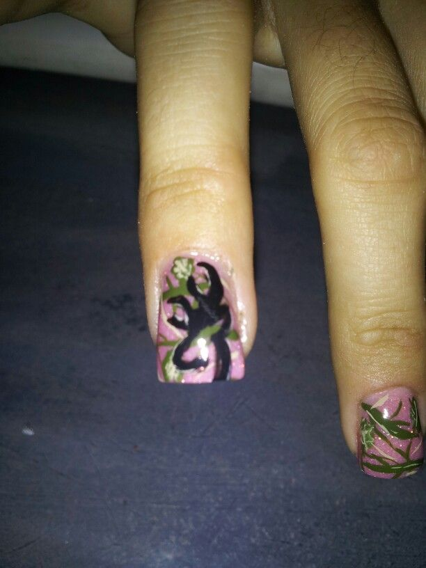 Tammy Taylor nail product. Handpainted camo nails & handpainted Browning Deer Head. No stickers or stamps.  Sculpted nails, no tips. Hand file, no drill used on nail plate. Nails done by me...Sandra