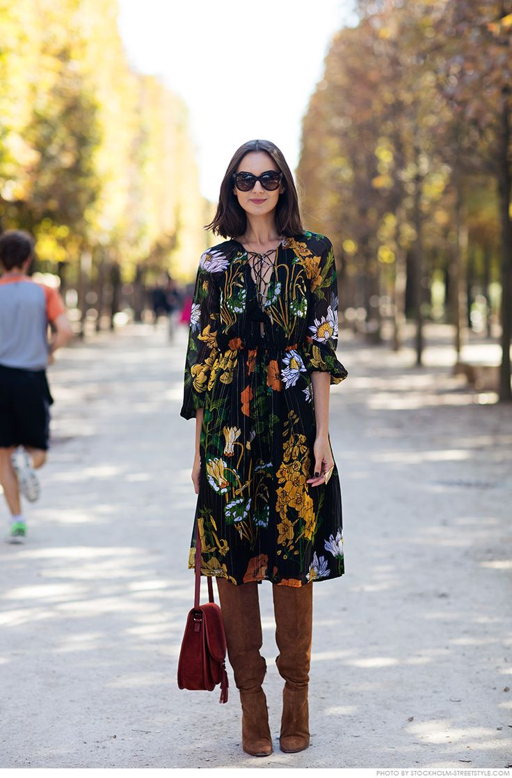 Nika Huk. Stockholm street style. I love this printed boho dress with knee high boots. Great fall outfit idea.