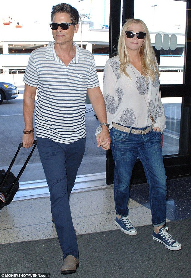 Lucky in love!Rob Lowe and his wife Sheryl Berkoff put on an affectionate display when th...