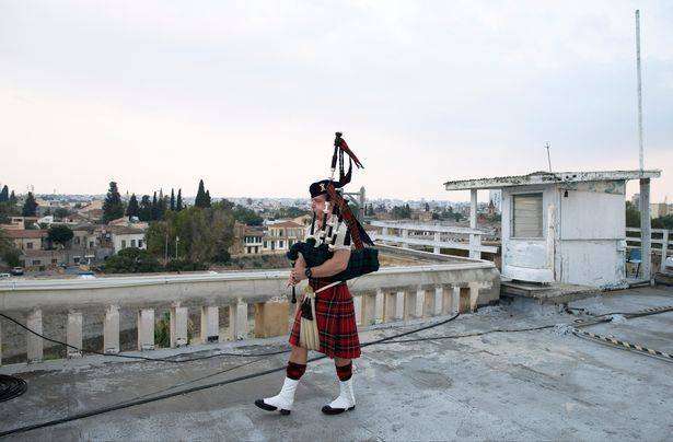 Piper John Ross Murdoch from Port Glasgow on the hotel roof