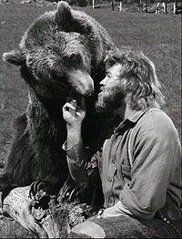 Dan Haggerty and Ben, 1977. Grizzly Adams (Haggerty) is a woodsman during the frontier era who flees into the mountains after he is wrongly accused of murder. While struggling to survive, Adams discovers an orphaned grizzly bear cub whom he takes in and calls Ben. The bear, despite his huge adult size, becomes Adams's closest companion.