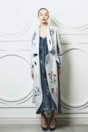 Sky blue long coat with side pockets, matching belt, round cut-outs at the front and printed flower details. 100% polyester Dry clean only Preorder will be shipped in ten days after the payment has been processed. Made in Georgia Model is wearing size S She is 179cm, bust 80cm, waist 60cm, hips 87cm