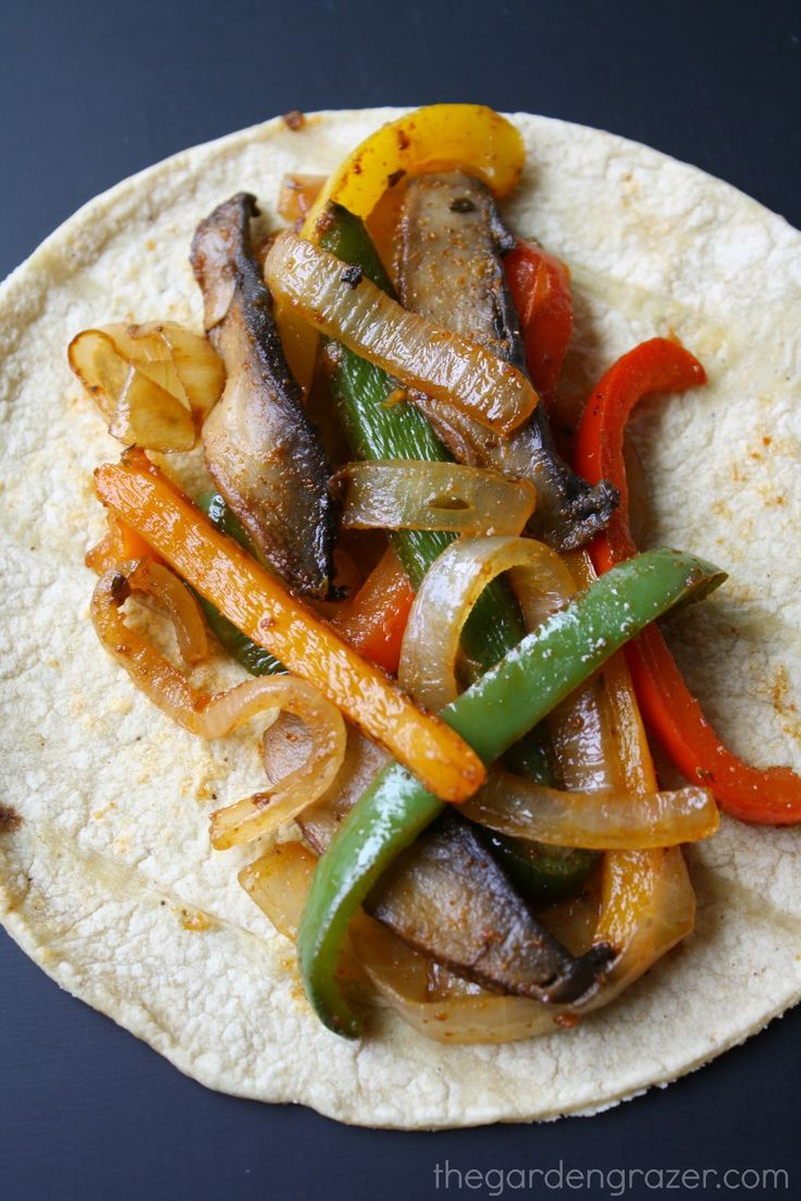 Portobello Fajitas 2-3 large portobello mushrooms 2 bell peppers 1 onion 1 Tbsp. taco seasoning (see below) Juice of 1/2 lime 1 Tbsp. olive oil, or more 6 corn tortillas (or other tortilla) Toppings of choice: avocado/guacamole, pico de gallo, dairy-free cheese, cashew sour cream