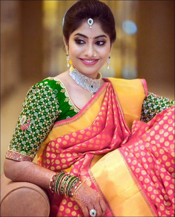 she choosed wissely with contrasting green color blouse for pink silk saree. This aari amd kundan work blouse added more beauty to her bridal makeover