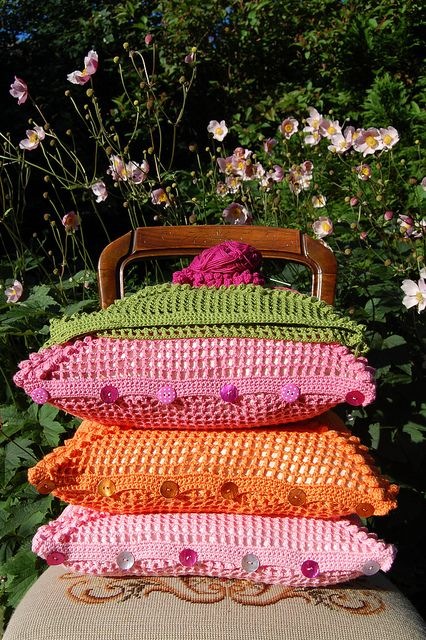 These hand crochet pillow covers in happy colors are divine.