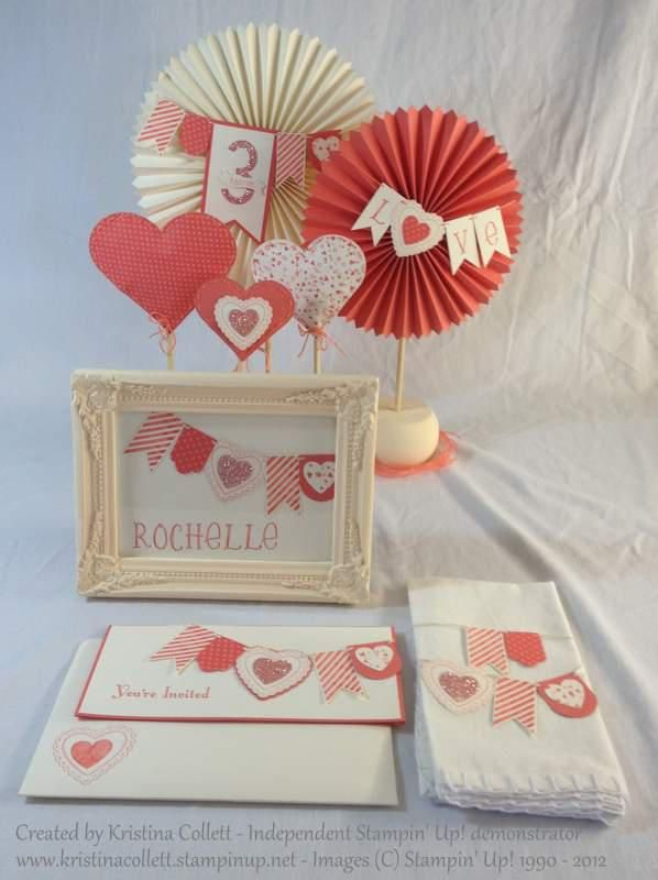 """""""Romantic rosettes""""  Features a folded invitation with matching handmade and stamped envelope, napkin decoration, free-standing centrepiece and a combined place card - photo frame bonbonniere all with pennant details. Available in a range of colours to suit your theme from Paper Pineapple www.facebook.com/Paperpineapple"""
