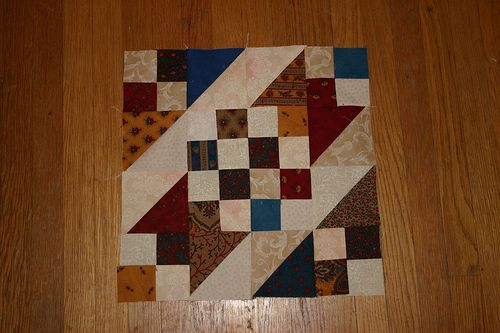the pattern is Sunny Lanes from Nickel Quilts by Pat Speth.  Four patch and HST