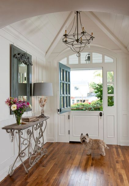 "Traditional Entry by Doug Simon ARCHITECTURE -Dutch door operations and French doors with simple materials, rich stains and unique glazing patterns."" If ornate finishes are not your cup of tea, try something with relaxed charm, like the Dutch door shown here. Paired with a fresh white interior, it lets the light and breezes flow."