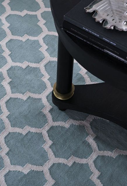Close-up on Layered's lovely rug Medallion Dusty Leaf. A dark table together with some bright beautiful textiles is always a great idea. Free worldwide delivery. See more at: http://layeredinterior.com/product/medallion/