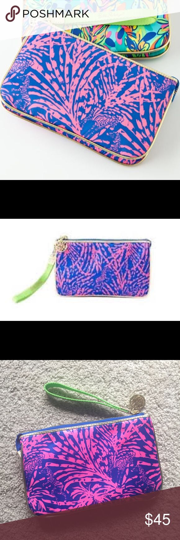 Rare Lilly Pulitzer Sapphire Blue Wristlet RARE Lilly Pulitzer Double Take Wristlet Sapphire Blue Rollin' in the Grass. NWOT in perfect condition. Nothing wrong with it I just never ended up using it. Doesn't include both wristlets shown in the first picture, only the pink/blue zebra Wristlet Lilly Pulitzer Bags Clutches & Wristlets