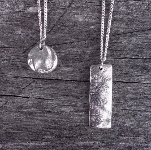 Fingerprint pendants. Best Mothers Day present I've ever received!! Love Gipsy Empire :)