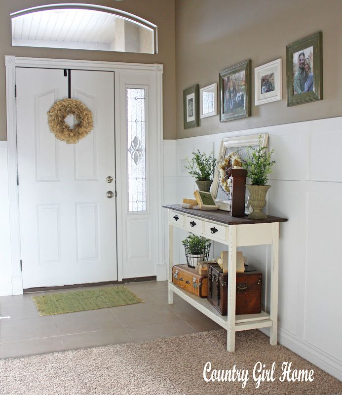 darling entry...love the board + batten, suitcases and book page wreath on the *inside* of the door