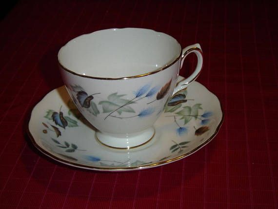 "Cup and saucer in the Linden pattern (#8162) by Colclough  The cup is 2 3/4"" (7 cm) high x 3 3/8"" (8.6 cm) at the brim and the saucer is 5 5/8"" (14.3 cm) in diameter  This cup is numbered B 36 4 and the saucer is numbered B 36 3  Made of bone china from England    These items have no nicks, chips, cracks, or signs of repair 