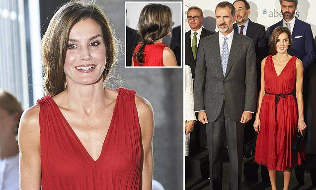 The Spanish Queen, 45, plumped for a bold red dress adorned with a chic black belt as she arrived at the Vocento anniversary concert at the Teatro Real in Madrid, Spain.