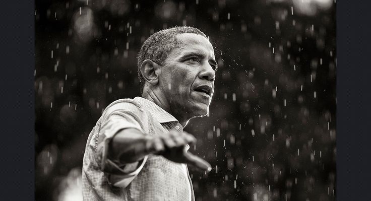 Obama speaks in the rain during a campaign rally in Glen Allen, Virginia, on July 14, 2012.