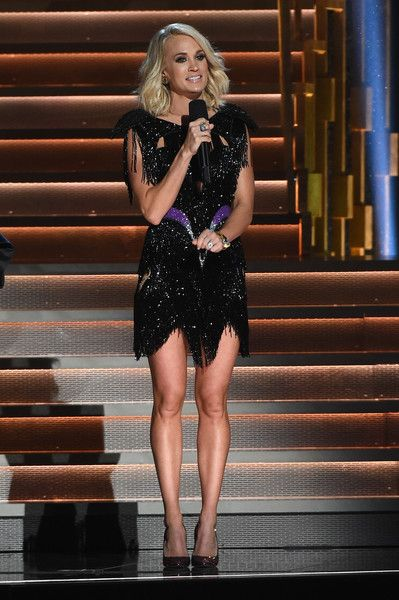 Carrie Underwood Photos Photos - Carrie Underwood wearing her 5th look of the evening, a 1980's inspired dress at The 50th Annual CMA Awards at Bridgestone Arena on November 2, 2016 in Nashville, Tennessee. - The 50th Annual CMA Awards - Carrie Underwood Fashion