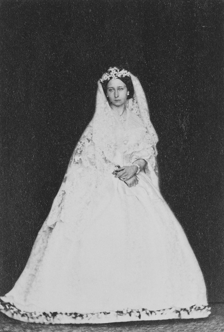 Princess Alice of the United Kingdom (daughter of Queen Victoria), in wedding dress, 1862. Her father, Prince Albert, had died less than a year before. The veil is the one her daughter, Alexandra, wore on her wedding day to Tsar Nicholas II. Just before Princess Alice's wedding she wore mourning black and right after the wedding she put back on the mourning black. Queen Victoria and some of Princess Alice's siblings cried during her wedding.