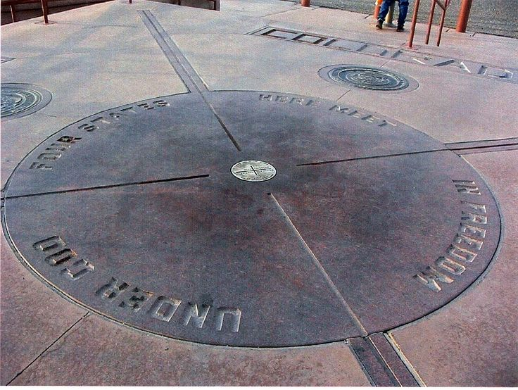 "four corners national monument - arizona, utah, colorado, & new mexico, usa. also includes two tribal boundaries which are the navajo nation and the ute mountain ute tribe. the monument reads ""four states here meet in freedom under God""."