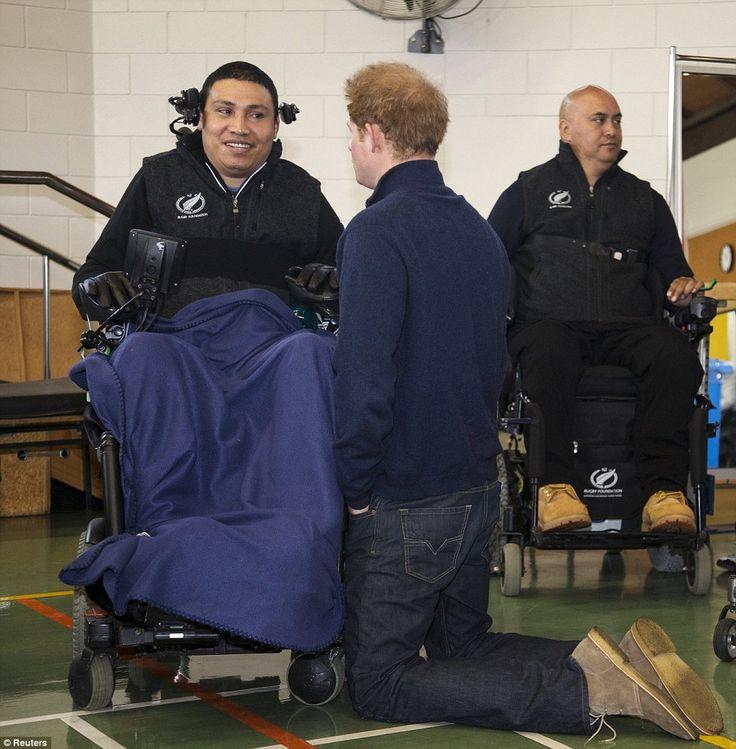 Moment Prince Harry kneels to speak eye to eye with a paraplegic man #dailymail