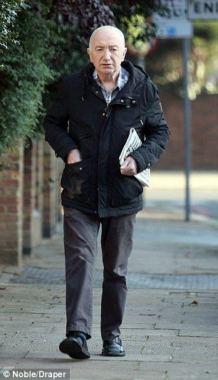 Low profile: John Deacon is pictured out and about in London