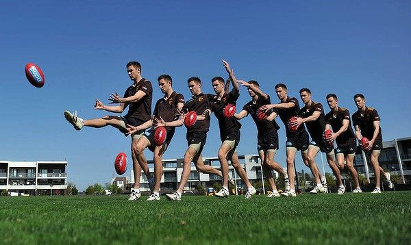 Multiple exposure of AFL Hawthorn footballer Jack Gunston, kicking the football.(The Age)