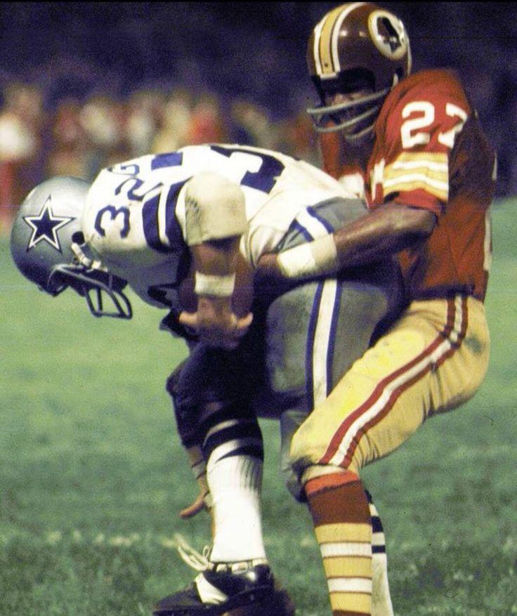Ken Houston stops Walt Garrison at the goal line on Monday Night Football.