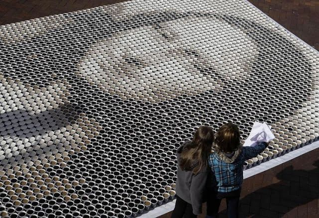 "Mona Lisa made out of coffee cups. As part of the annual festival ""The Rocks Aroma Festival"", held in Sydney, the Aroma Team built large-scale mosaics out of coffee cups representing Marilyn Monroe and Mona Lisa. Creating these images took 5200 cups of coffee, which contained 780 liters of coffee and 680 liters of milk."