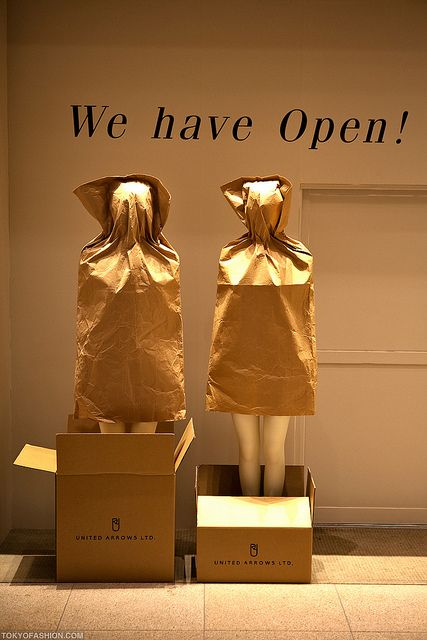 Mannequins in paper bags. Super fun gift season window
