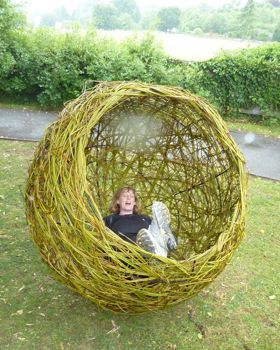 Willow woven onto a steel frame, this large willow sphere makes a striking feature in a garden and is a lovely place in which to sit! Made to order.
