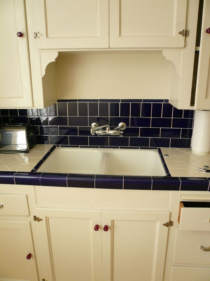 And this wonderful 1930s kitchen, still with its original red glass door knobs