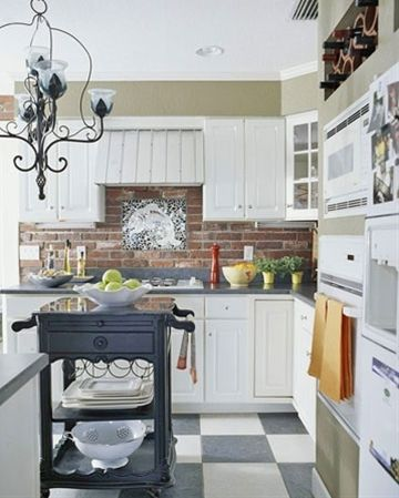 red brick backsplash, white cabinets, black countertops
