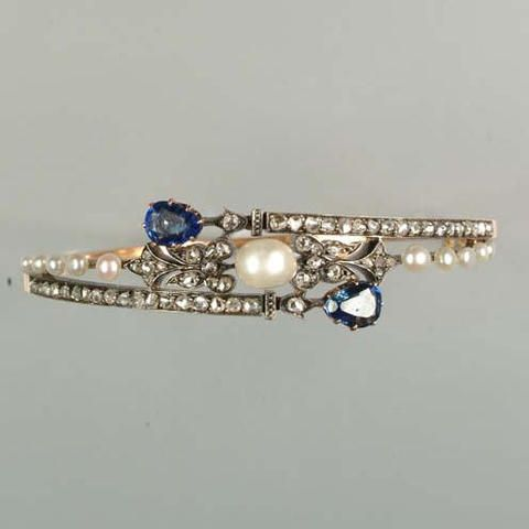 A late 19th century pearl, diamond and sapphire hinged bangle,
