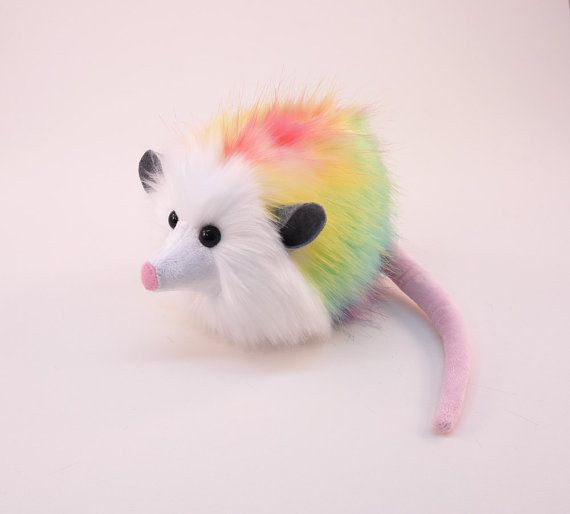 This rainbow opossum: | 24 Stuffed Toys For Your Totally Weird Significant Other