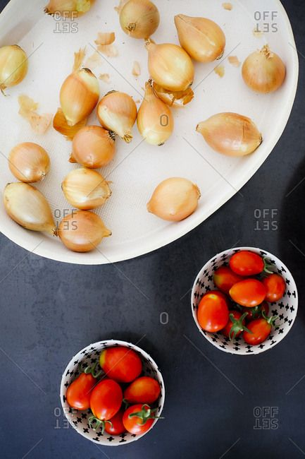 Fresh onions and tomatoes in bowls