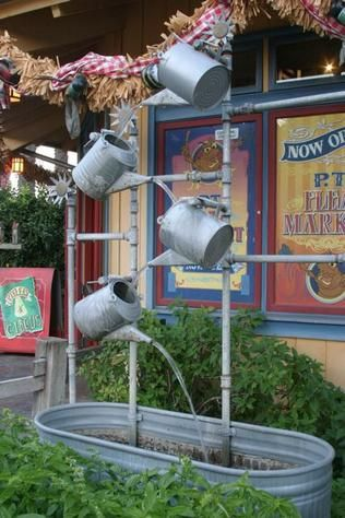 """""""A whimsical watering can fountain adorns the entrance to PT Flea Market."""" Anaheim, California photo of """"Watering Can Fountain"""" by IgoUgo travel photographer, AgedToPerfection."""