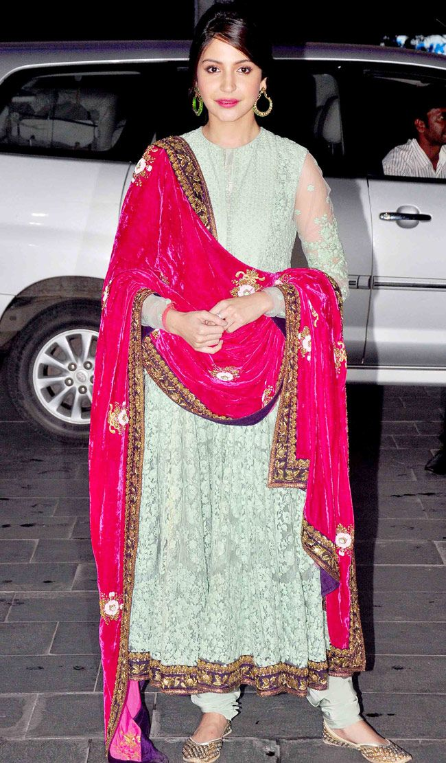 Anushka Sharma in a red velvet dupatta and Anarkali dress at Shirin Morani's wedding reception.